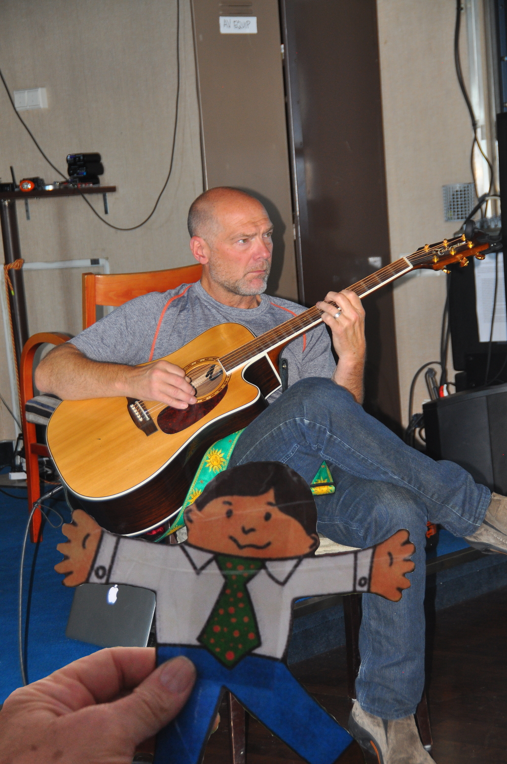 FS with Survivorman playing guitar